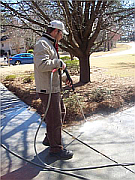 Stockbridge Power washing a home driveway